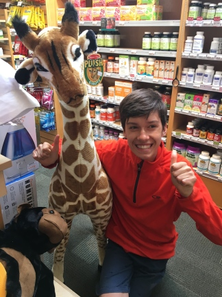 Trying to convince me he needs this giraffe